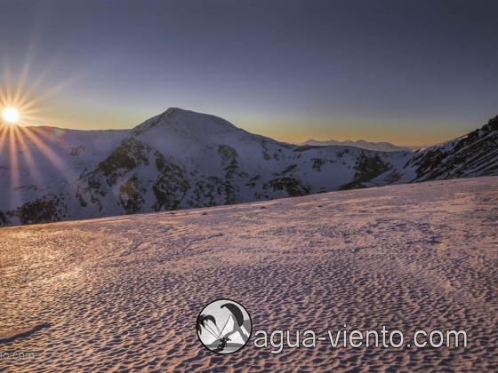 Sundown on winter landscape in Cerdanya with view to Port de Perafita - the border to Andorra